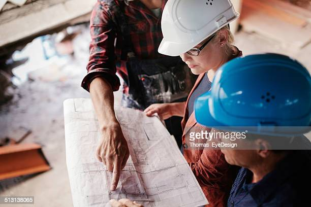 Construction Foreman Looking Over Blueprints