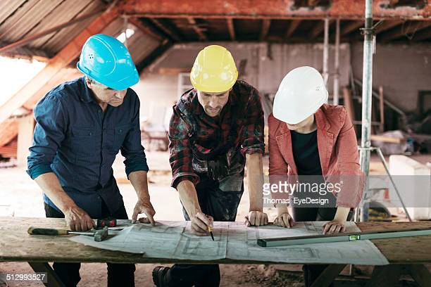 Construction Foreman Meeting with Architects