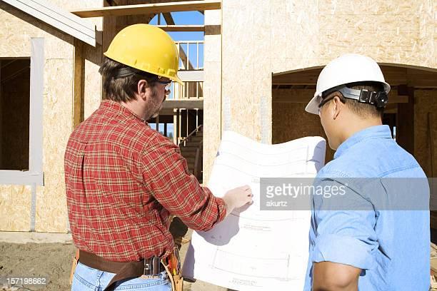 Construction foreman verifying progress