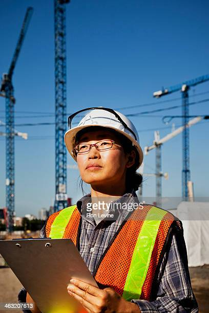 Construction forewoman using clipboard