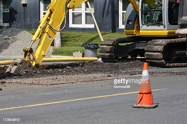 Construction hoe digging pipe for gas line