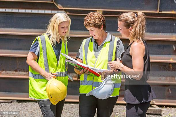 Construction Industry Women in High Visibility Safety Clothes
