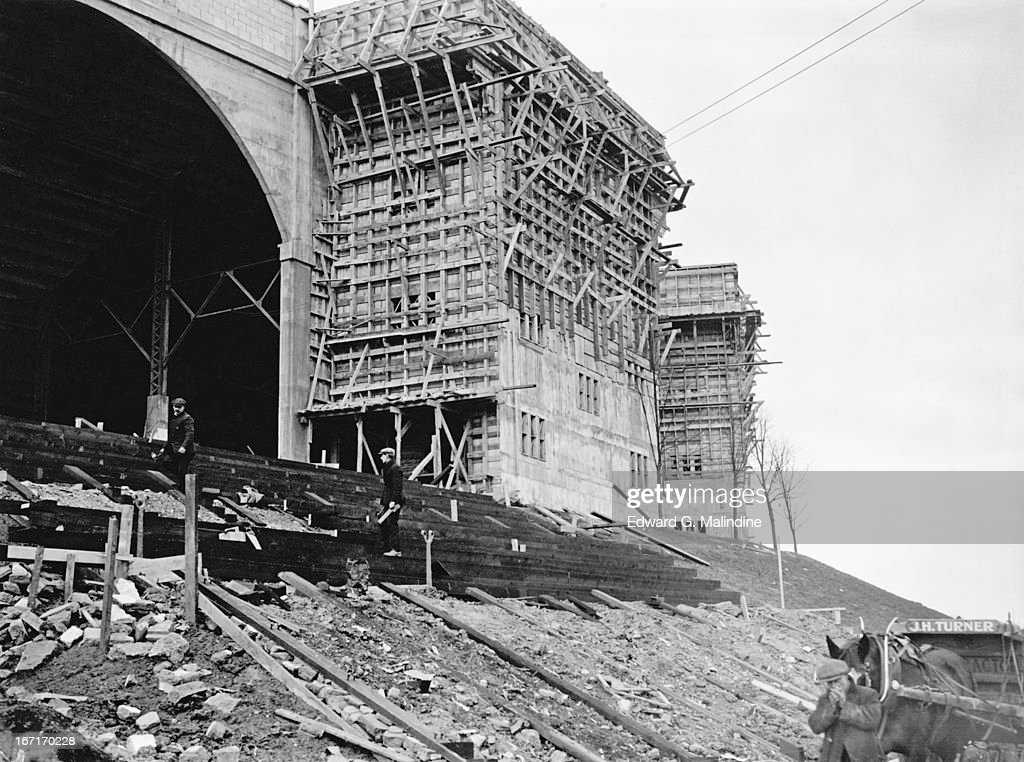 Construction is under way on the two towers at Wembley Stadium, 14th February 1924. Stairways are being built within the towers to enable latecomers to take their seats without interrupting earlier arrivals.