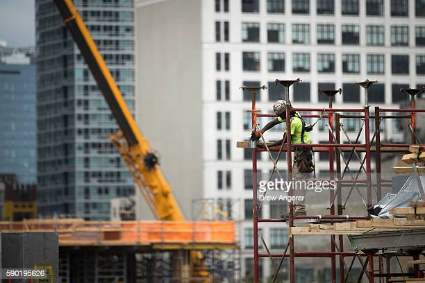 A construction laborer works on the site of a new residential building in the Hudson Yards development August 16 2016 in New York City Home...