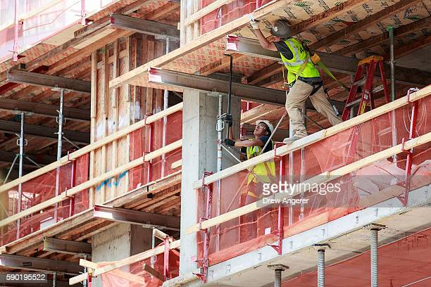 Construction laborers work on a new residential building August 16 2016 in the Brooklyn borough of New York City Home construction in the US...