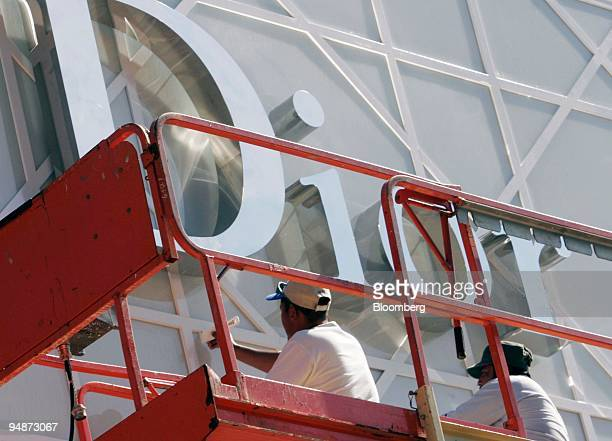 Construction laborers work on a sign at a new store located in the Chevy Chase Center construction site on Monday October 3 2005 in Chevy Chase...