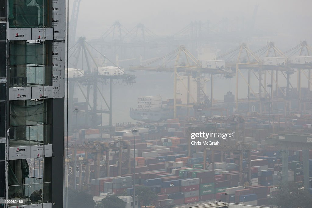 A construction labourer works on a new building as smoke haze engulfes the Singapore port on April 19, 2013 in Singapore. The haze was created by burning off in neighbouring Sumatra and caused the Pollutant Standards Index to rise, hovering between 28 and 43.