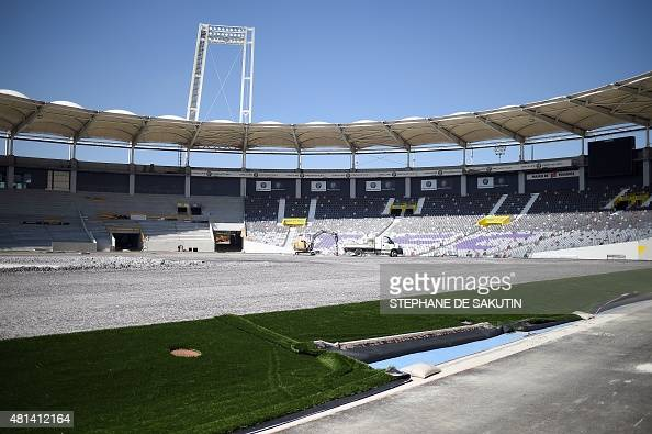 Construction labourers work on the renovation of the Municipal Stadium in Toulouse southwestern France on July 20 2015 ahead of the Euro 2016...