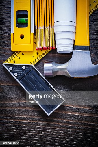 Construction level square ruler blueprint roll wooden meter and : Stock Photo