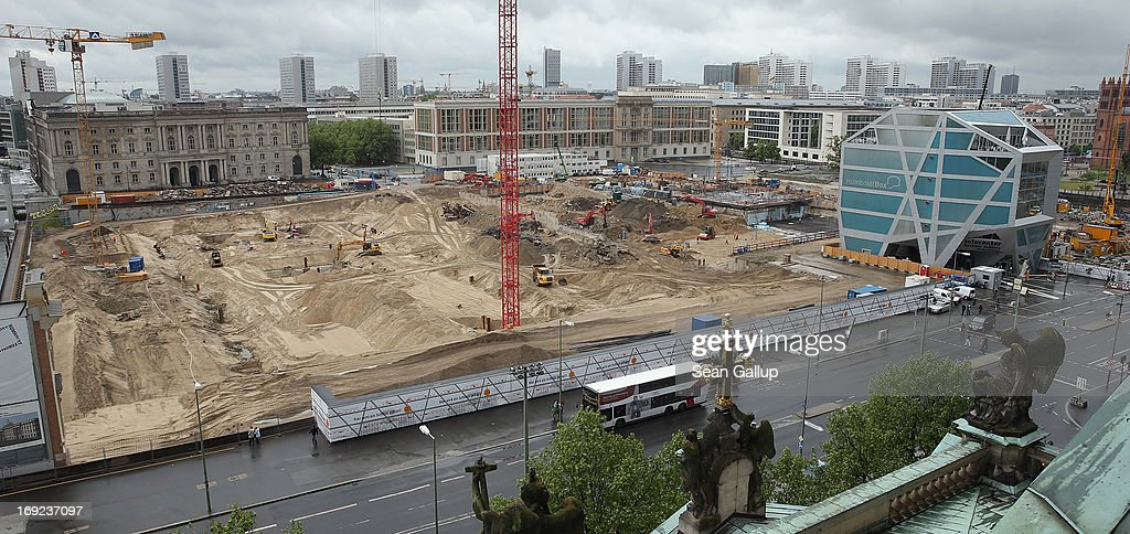 Construction machines, cranes and workers are visible on the construction site of the Berliner Schloss city palace on May 22, 2013 in Berlin, Germany. The Berliner Schloss was the residence of the Prussian Kaiser and was among the major architectural landmarks of Berlin until it was heavily damaged by Allied bombing in 1945. The communist authorities of East Berlin demolished the building in the 1950s, and today's Berlin government is pursuing an ambitious project to rebuild the palace according to a design by Italian architect Franco Stella, which will recreate the facade of the building but with a modern interior at a cost of approximately EUR 590 million.