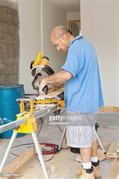 Construction: Man using Miter Saw