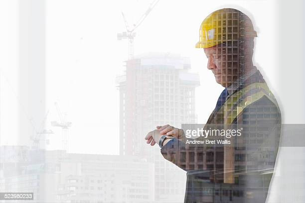 Construction manager uses smart watch on site