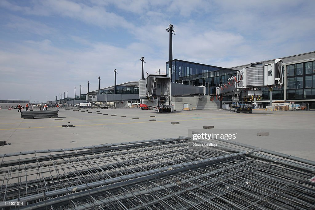Construction material lies near jetways on the tarmac at Willy Brandt Berlin Brandenburg International Airport on March 20, 2012 in Berlin, Germany. The new airport, which will replace the city's current Tegel and Schoenefeld airports, will officially open in May and begin operation on June 3.
