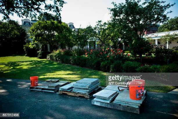 Construction materials are seen near the Rose Garden during summer renovations to the White House on August 22 2017 in Washington DC / AFP PHOTO /...