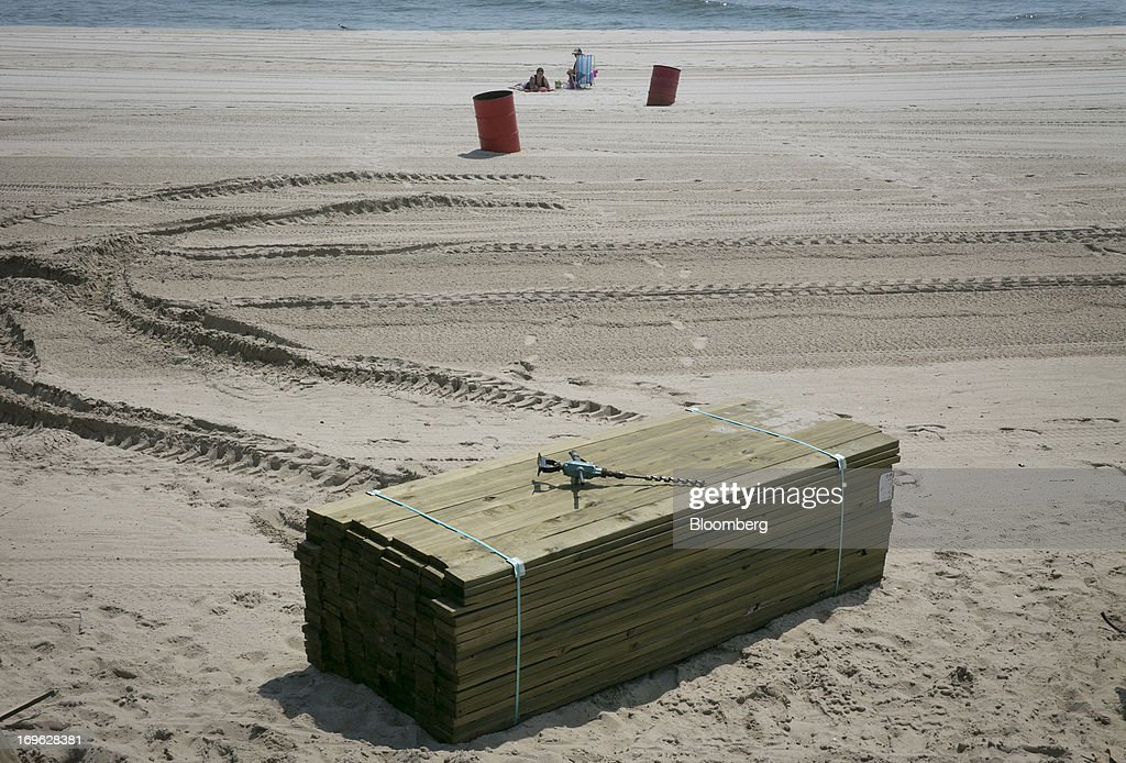 Construction materials sit on the beach in Seaside Heights, New Jersey, U.S., on Wednesday, May 29, 2013. Sandy, which came ashore near Atlantic City, killed dozens of people and destroyed more than 365,000 homes in the state. Christie has said it will cost $36.9 billion for repairs and to prevent devastation from future storms. Photographer: Scott Eells/Bloomberg via Getty Images