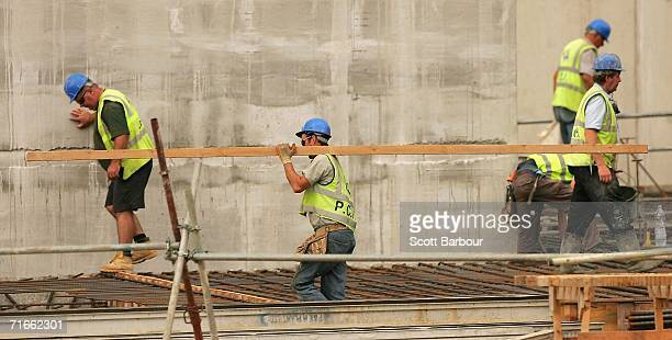 Construction men work on a shopping centre being built by construction group Multiplex in White City on August 17 2006 in London England...