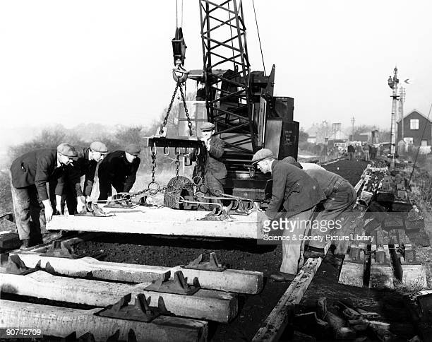 Construction of a railway 1949 British Railway Western Region workers using a special rig to lay concrete sleepers at Ketley England 6 February 1949