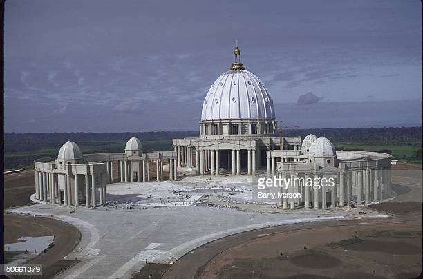 Construction of St Peter'slike Basilica of Our Lady of Peace pet project of Pres Felix HouphouetBoigny convert to Roman Catholicism