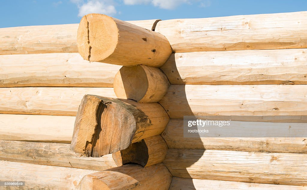 Construction of the handcrafted scribe fit log house : Stock Photo