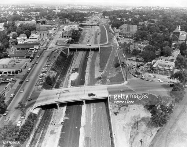 Construction of the Massachusetts Turnpike toll road in Newton Corner Aug 18 1964 On right hand side is new fire station On left upper side of toll...