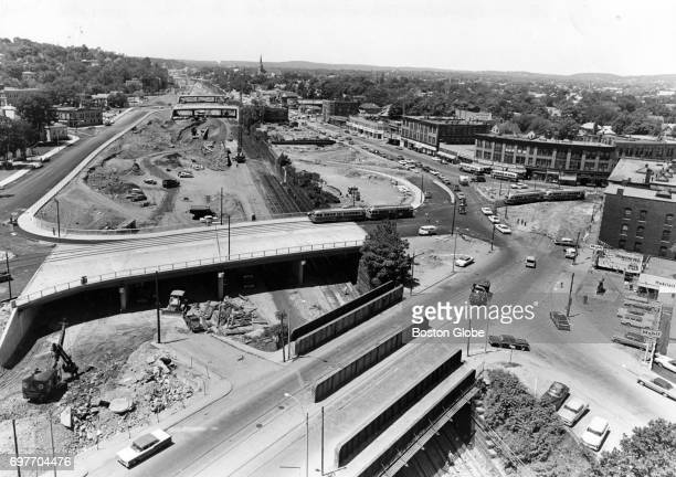 Construction of the Massachusetts Turnpike toll road in Newton Corner June 17 1964 Old MTA tracks and relocated MTA tracks over the new bridge can be...