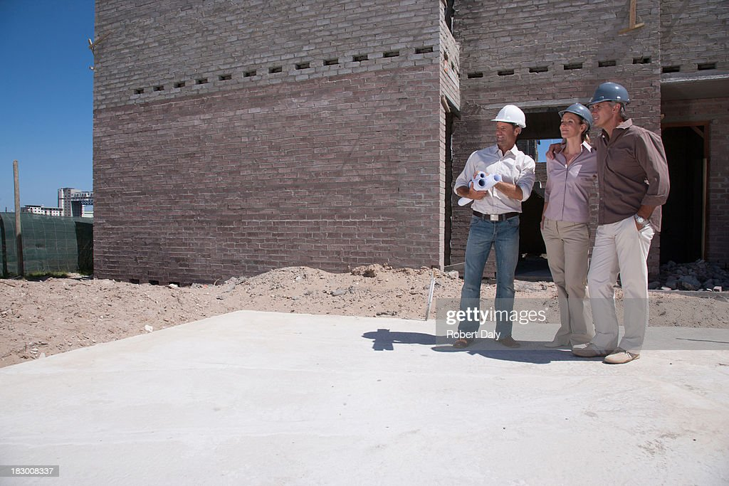 Construction people on construction site : Stock Photo