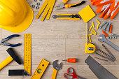 Work Tools frame on wood bakcground