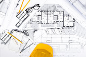 Top View of Construction plans with Tablet, drawing and working Tools on blueprints; Architectural and Engineering Housing Concept.
