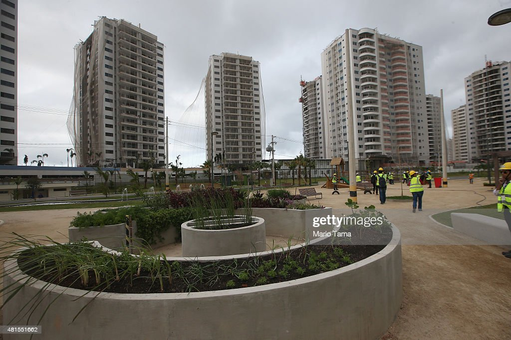 Construction progress takes place during a tour of the Ilha Pura housing complex the future site of the Athletes' Village for the Rio 2016 Olympic...