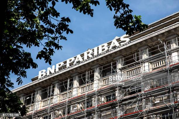 Construction scaffolding surrounds the BNP Paribas SA headquarters in Paris France on Tuesday July 18 2017 BNP Paribas agreed to pay $246 million to...