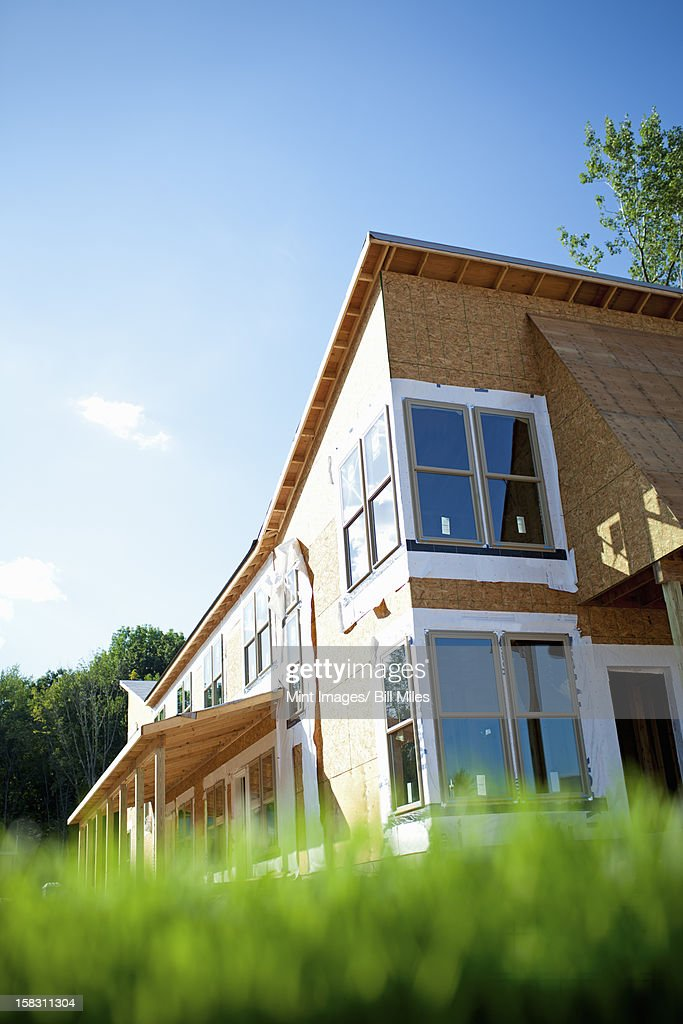 A construction site, a domestic house being built in a rural setting in New York State, USA : Stock Photo