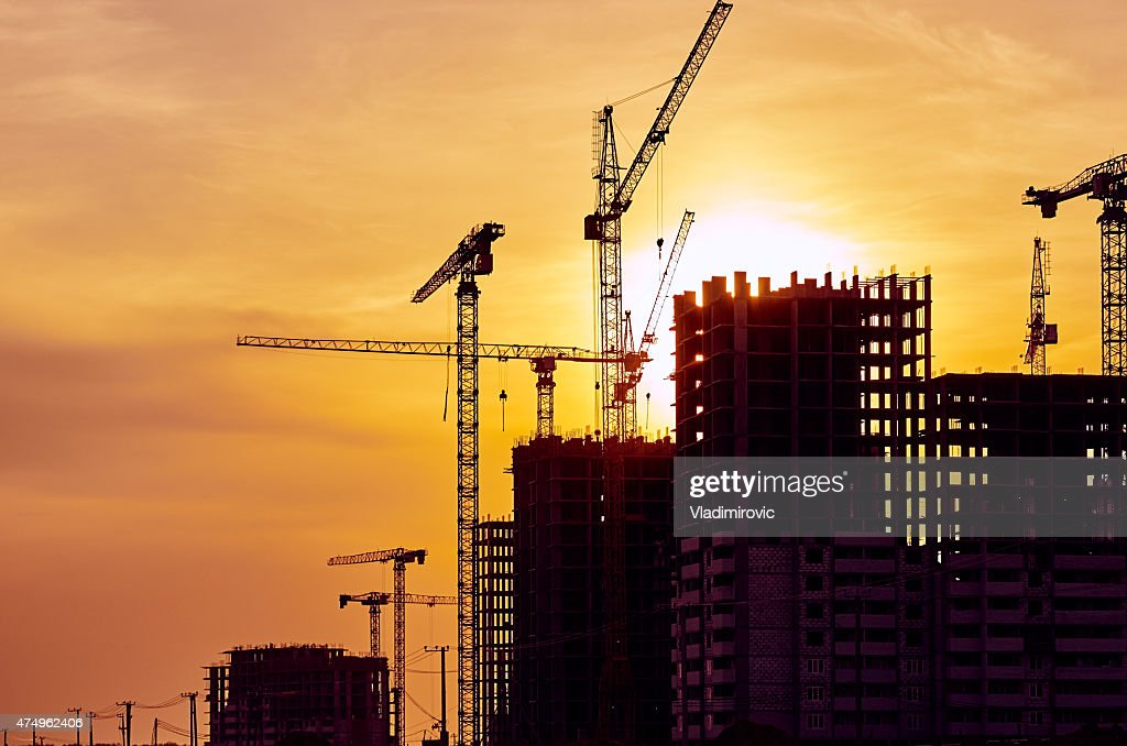 Construction site crane at dusk crane : Stock Photo