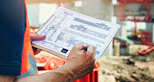 Construction Site Engineer Working Blueprint