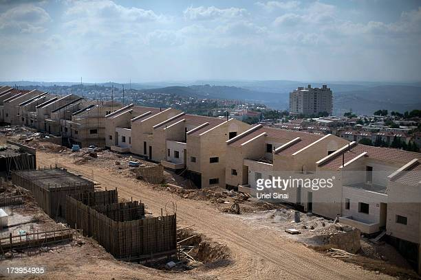A construction site for a new neighborhood is seen on July 18 2013 in the Jewish Settlement of Ariel in the West Bank Israeli President Shimon Peres...