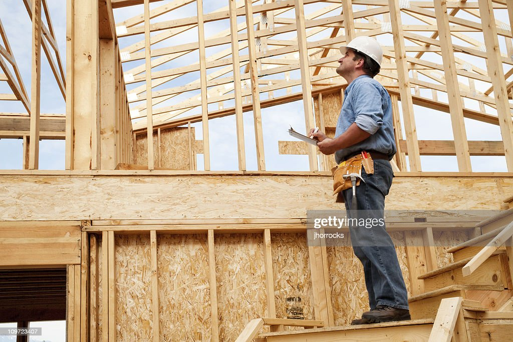 Construction site inspection stock photo getty images for Homebuilder com