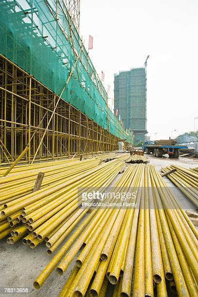 Construction site, metal beams on ground
