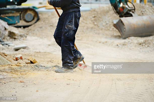 Construction site, piles of sand, scoop