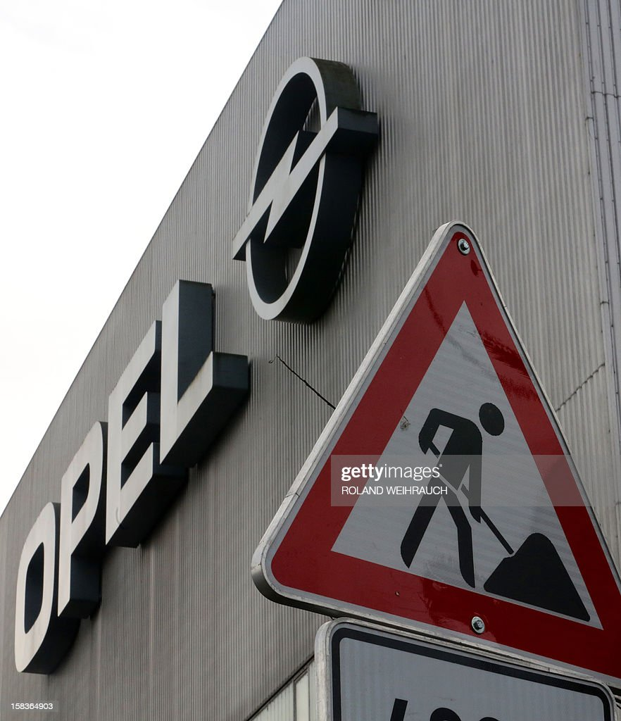 A construction site sign stands at a construction site in front of the Opel factory in Bochum, western Germany, on December 14, 2012. Opel, the loss-making German arm of US auto giant General Motors, said on December 10 it would halt auto production at its Bochum plant in 2016 but pledged to keep the site running as a parts distribution centre. Thomas Sedran, CEO of Opel said on Decemebr 14 it will not close any other plants in Europe. AFP PHOTO / ROLAND WEIHRAUCH/GERMANY OUT