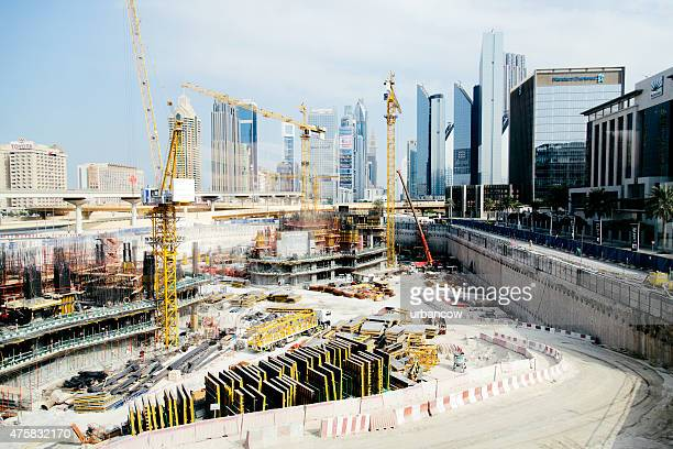 Construction site, skyscrapers, cranes on the Dubai cityscape skyline