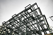 Shot of steel frame made of rsjs on a construction site in cloudy weather