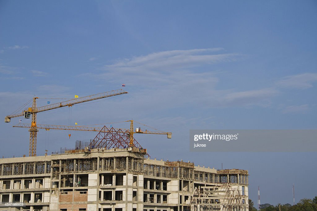 Construction site with crane and building : Stock Photo