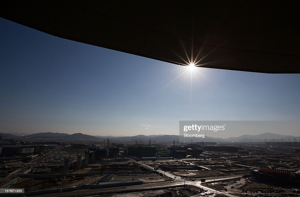 Construction takes place in Sejong, South Korea, on Tuesday, Dec. 4, 2012. The construction of Sejong City 120 kilometers (75 miles) south of the capital fulfills the vision of the late President Roh Moo Hyun, who pledged to reduce the dominance of Seoul and pump money into a region courted for its swing voters. Photographer: SeongJoon Cho/Bloomberg via Getty Images
