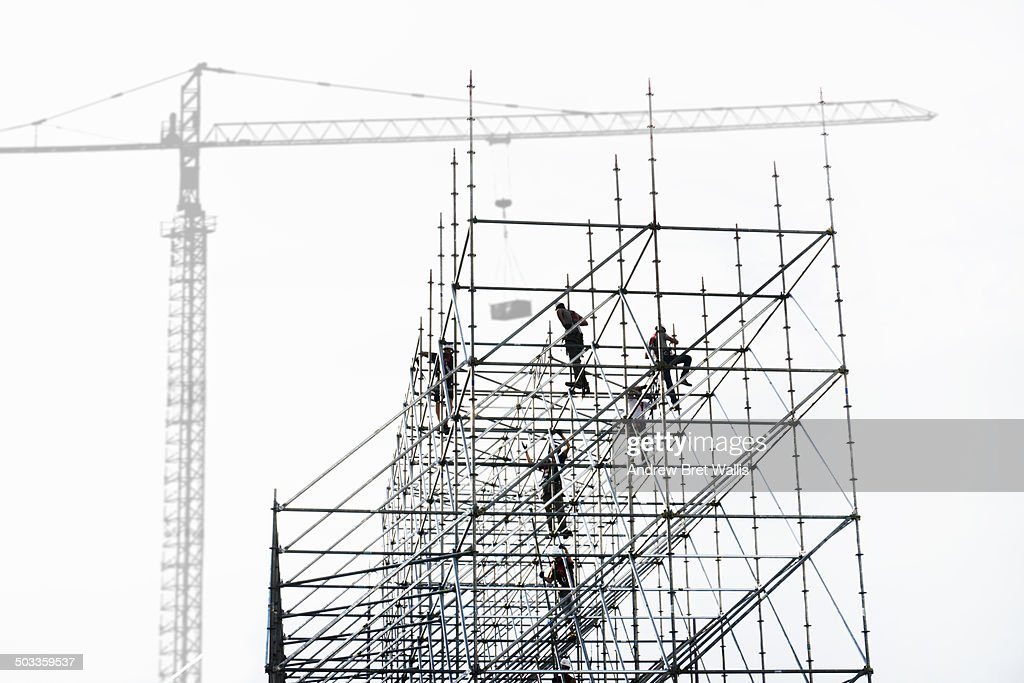 Construction team erecting scaffolding
