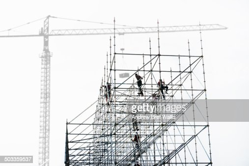 Construction team erecting scaffolding