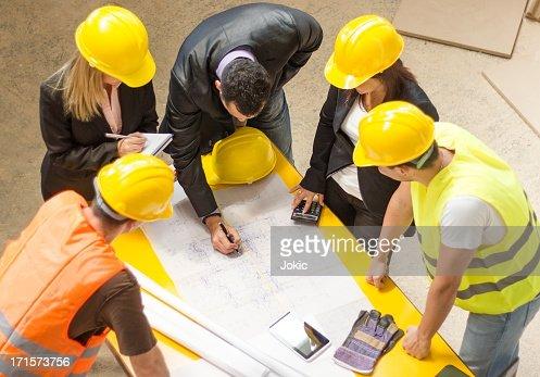 Construction team going over building blueprints