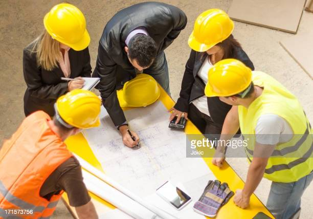 Construction team going over building blueprints