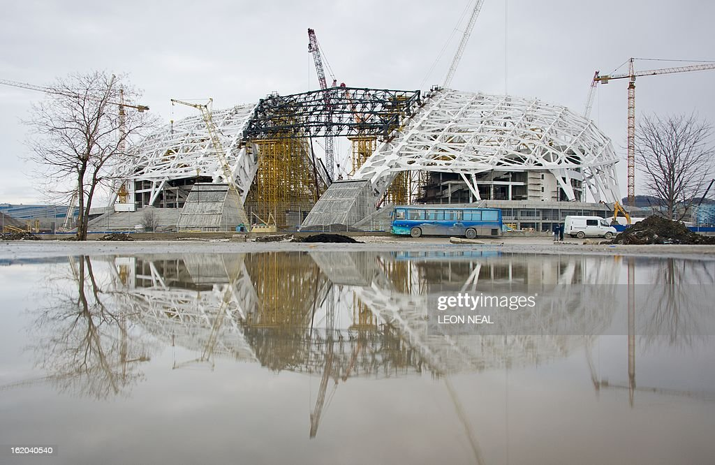 Construction teams work on the Fisht Olympic Stadium in the Adler district of Sochi in Russia on February 18, 2013. With a year to go until the Sochi 2014 Winter Games, construction work and development continues as Olympic tests events and World Championship competitions are underway.
