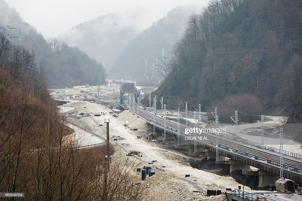 Construction teams work on the new Olympic train line and road linking Adler to Krasnaya Polyana and Rosa Khutor in Sochi, Russia, on February 18, 2013. With a year to go until the Sochi 2014 Winter Games, construction work and development continues as Olympic tests events and World Championship competitions are underway.