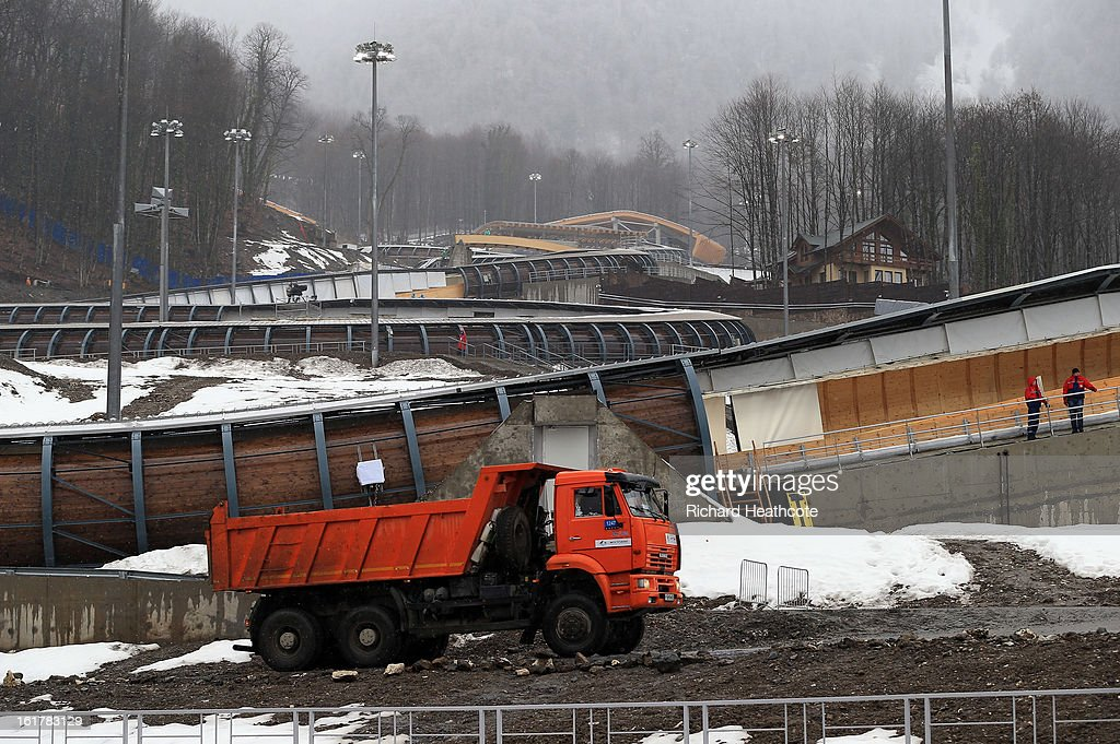 Construction trucks drive around the track during the Viessman FIBT Bob & Skeleton World Cup at the Sanki Sliding Center in Krasnya Polyana on February 16, 2013 in Sochi, Russia. Sochi is preparing for the 2014 Winter Olympics with test events across the venues.