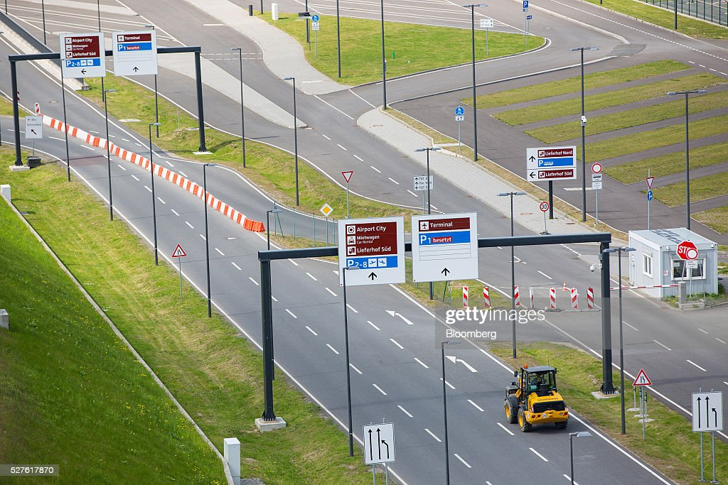 A construction vehicle travels on a road outside Berlin Brandenburg International Willy Brandt Airport in Schoenefeld, Germany, on Monday, May 3, 2016. The massively overbudget airport was planned to open in 2010 and handle 27 million passengers a year, crowning Berlin as the continent's 21st century crossroads. Photographer: Krisztian Bocsi/Bloomberg via Getty Images